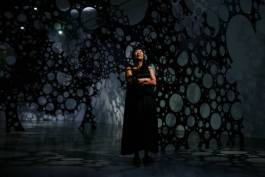 Artist Lindy Lee poses from inside her sculptural work Moonlight Deities. Photo: Don Arnold/WireImage